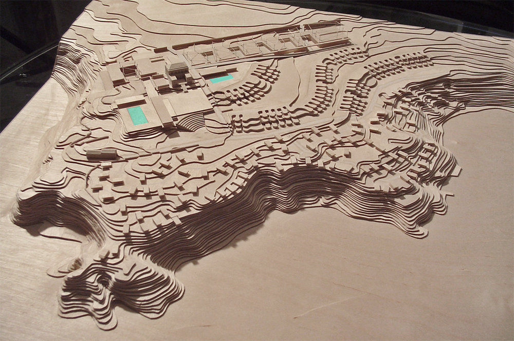 study models of the new master plan   Throughout the years, diverse regional and national regulations have been established in order to preserve the exceptional beauty of the coastline. The resort has always taken into consideration this regulations by not building anything visible from Cefalù and adopting a temporary character for the construction visible from the sea keeping a low profile in accordance with Club Med's founding philosophy.  The project aims to do this by maintaining the existing landscape -particularly species which are unique to the site, and by adopting local building traditions and materials. The programmatic requirements nevertheless make quite heavy demands on the site in terms of the amount of building work planned. Raising the accommodation standard from camping in straw huts to 4star+ requires more overall built volume. We have sought to make this necessity compatible with the natural features of the site.