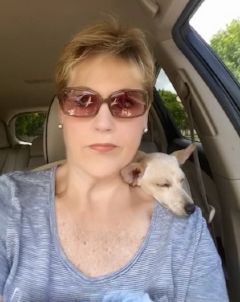 "- Elaine Johnson works full-time with Pet Pals taking care of daily, weekend, and holiday visits. She is very upbeat and enthusiastic about all the pets in her care, but we secretly call her the ""cat whisperer""."