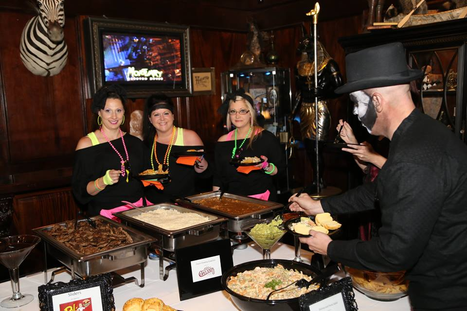 Soiree Spooktacular guests pausing to enjoy some classic New Orleans fare.jpg