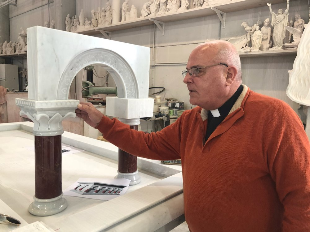 Father Barranger inspecting the carvings for the altar columns at the studio in Pietrasanta, Italy.