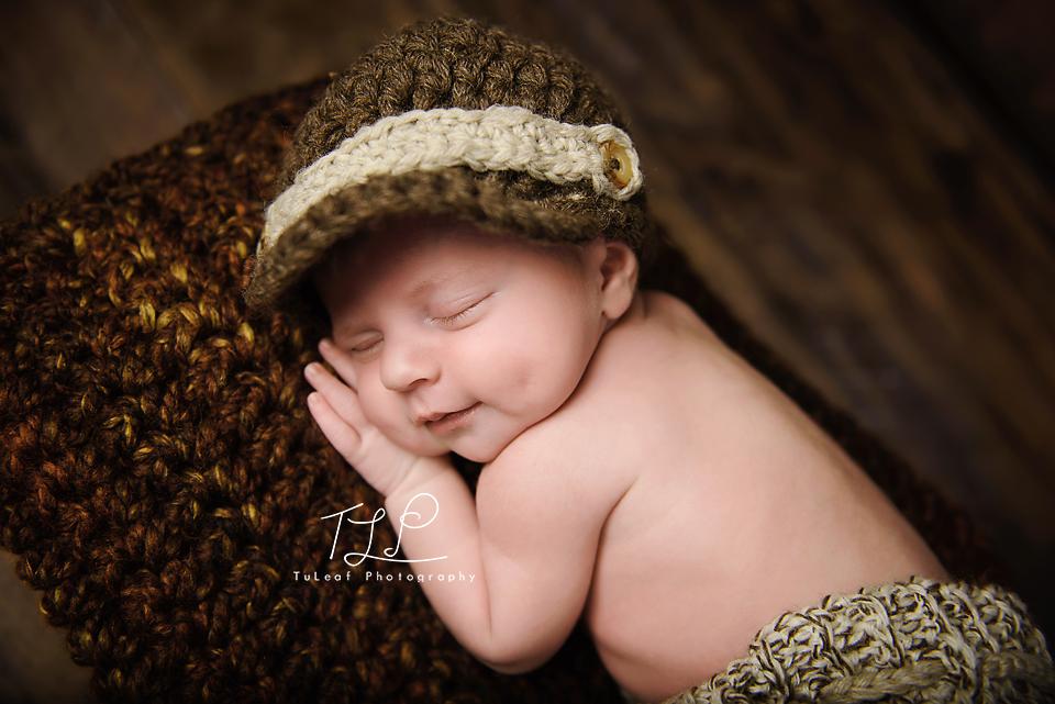 albany ny newborn photographer smiley baby