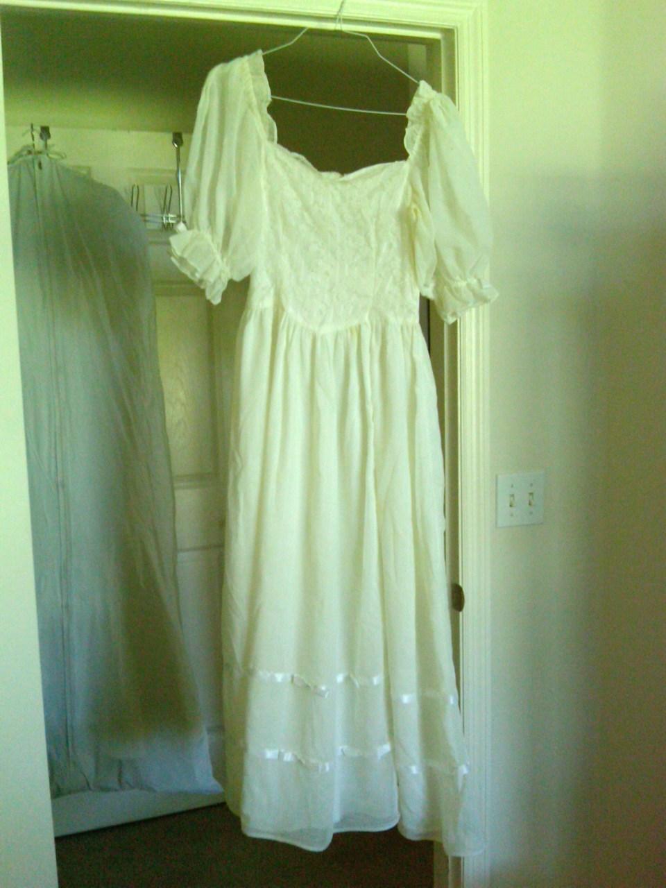 My mom's wedding dress, and mine hidden behind it.