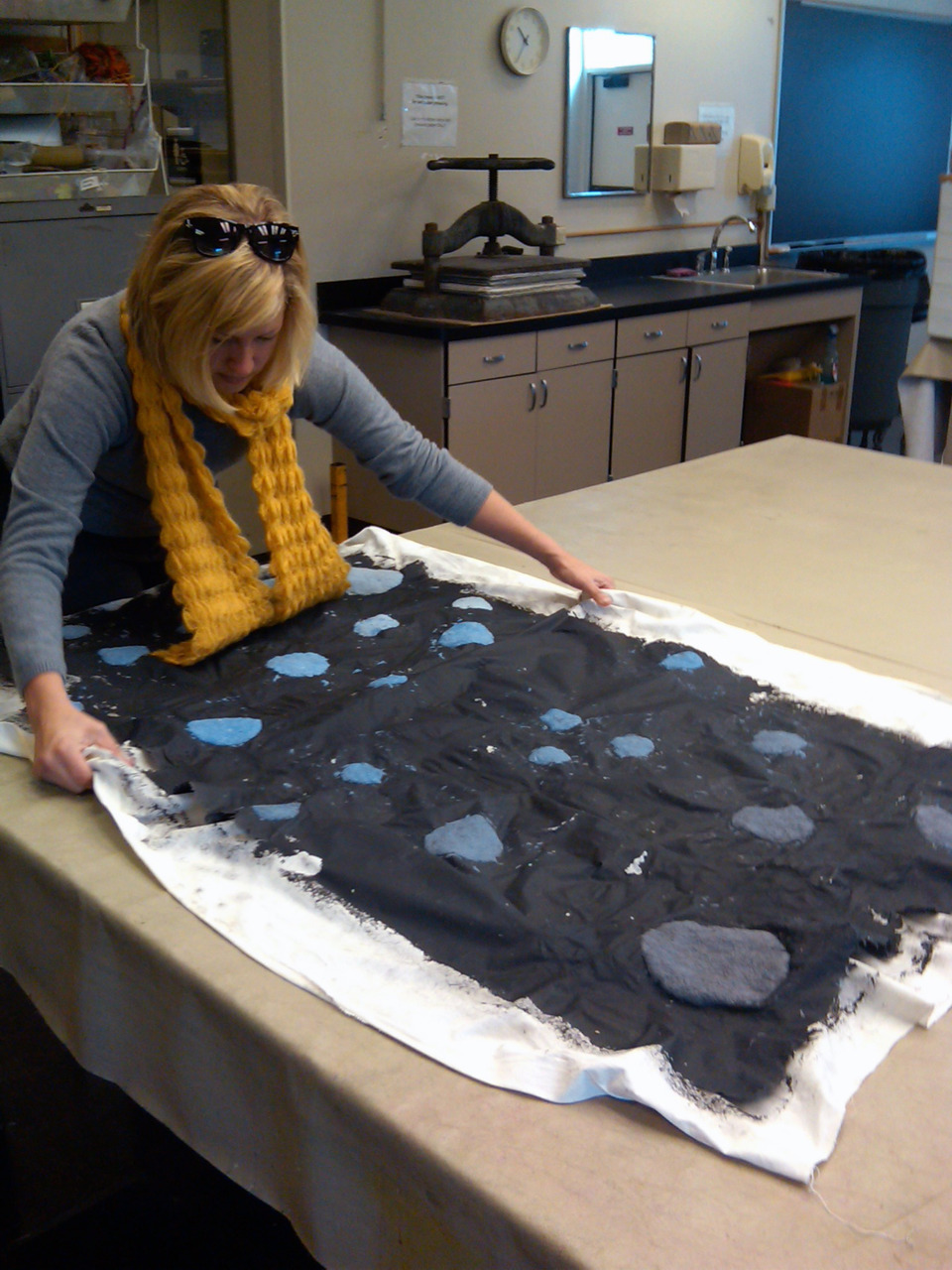 My friend, Delaney, removing her papermaking project from its cloth support.