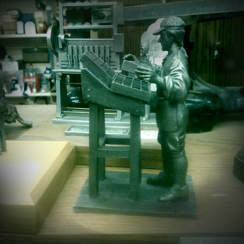 Figurine of a man setting type we found at the mini mall.