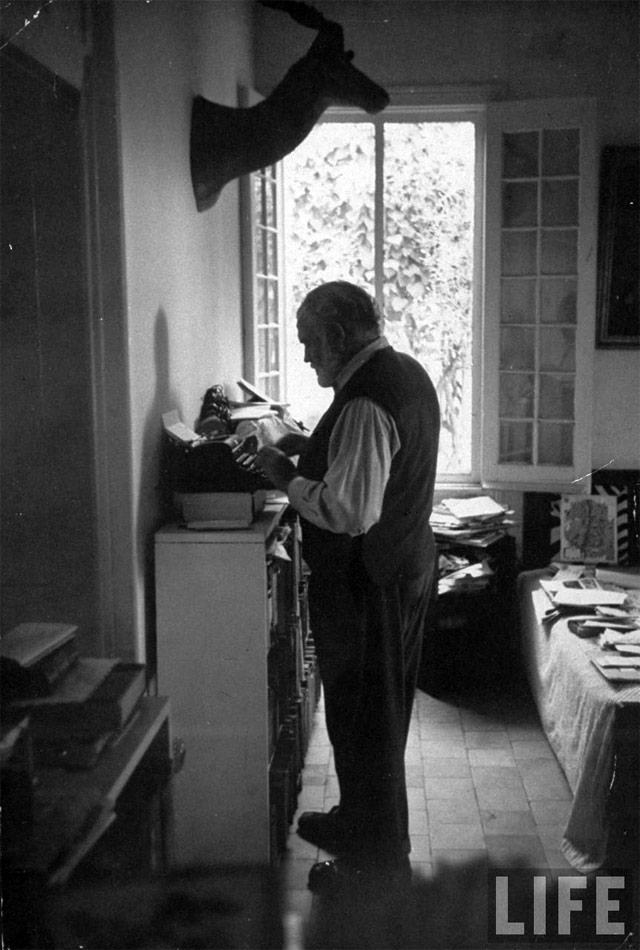 workspaces: Ernest Hemingway's standing desk: A working habit he has had from the beginning, Hemingway stands when he writes. He stands in a pair of his oversized loafers on the worn skin of a lesser kudu — the typewriter and the reading board chest-high opposite him. - Paris Review, 1958 via kottke