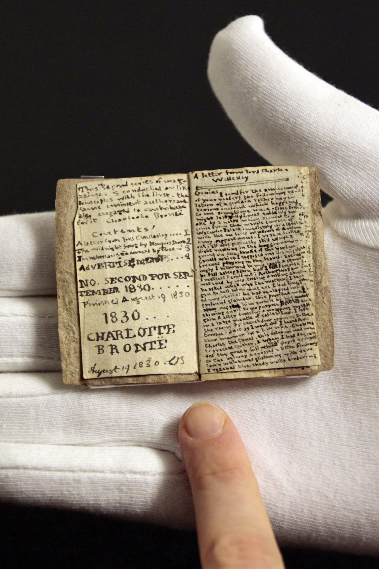 nparts: Museum unveils Bronte's teeny tiny early work A manuscript by British author Charlotte Brontë that fits comfortably into the palm of a hand that fetched 691,000 pounds ($1.1 million) at a Sotheby's auction in December, more than twice the upper estimate, went on display this week.