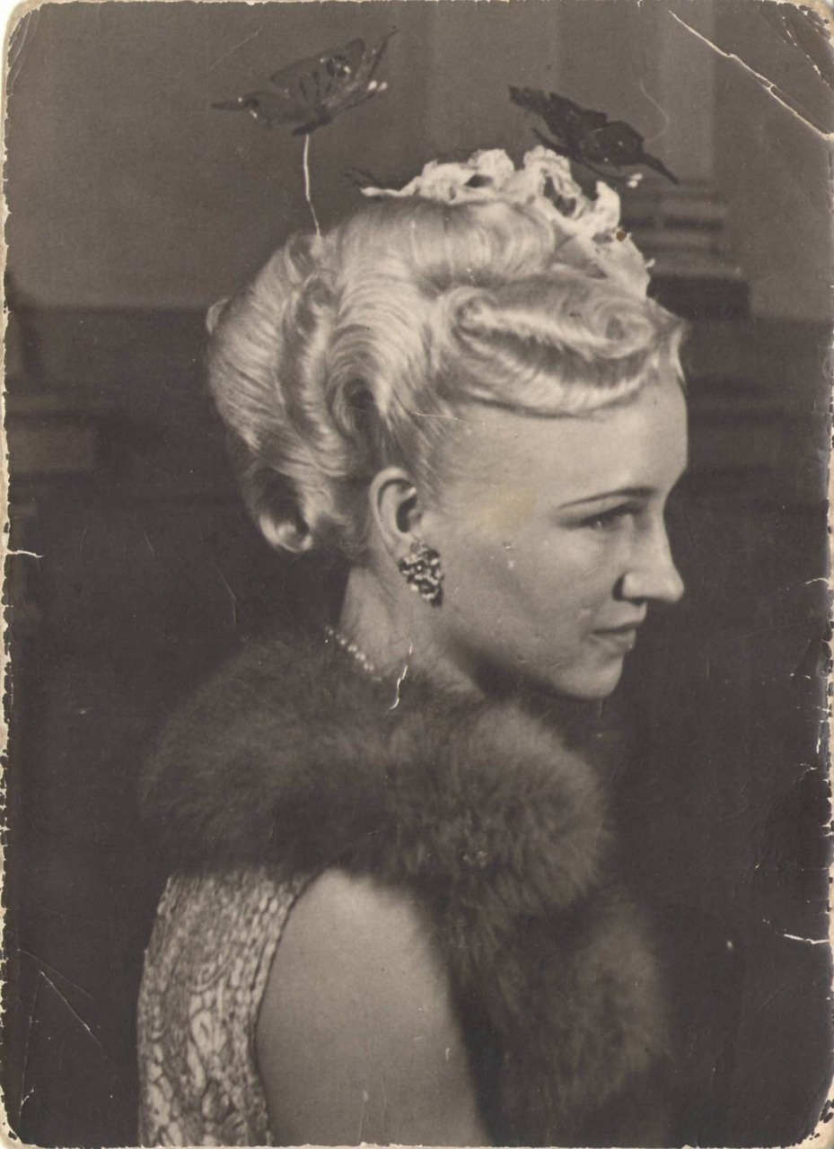 forgottenantiquities: My late Grandmother who used to work as a hairstyle model. Note the glass butterflies on the pins in her hair. Submitted by white-collar-smut (NSFW)
