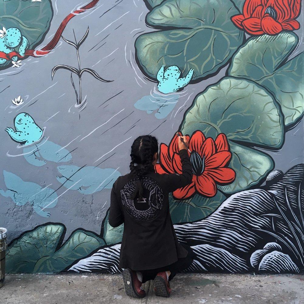 K. Choy at work on  Evolution/Extinction  (collaboration with Mazatl): Cholula, Puebla, Mexico, Photo Credit: Mazatl