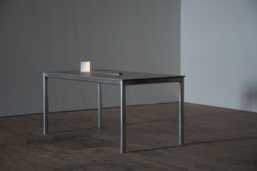 "Movie for a table , concrete, aluminum, pico projector, mirrors, paper, 2013 (installation view "",,,"" Soap Factory, Minneapolis)"