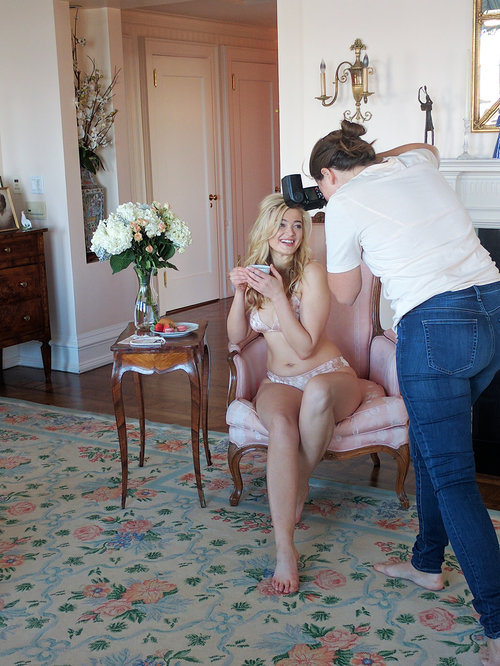 Behind the scenes fashion, lingerie designer Angela Friedman and model during photo shoot, silk slips and luxury lingerie