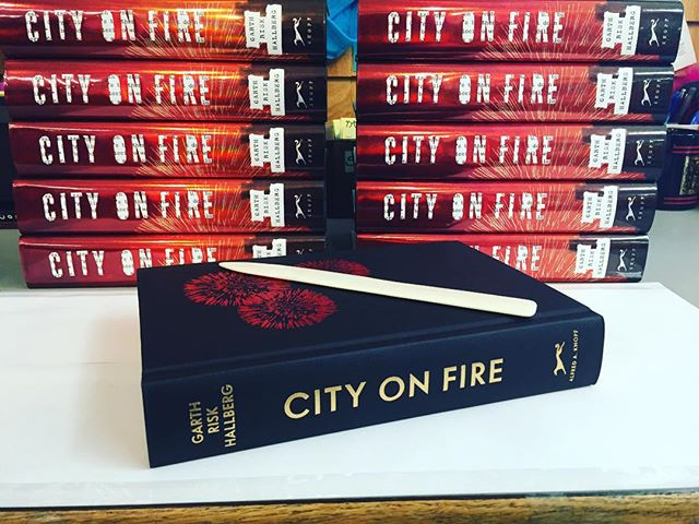 Preparing for our event with Garth Risk Hallberg for City on Fire tonight!! I'm putting the protective Mylar on the jacket. His is our November selection. Thank you @penguinrandomhouse @aaknopf for the beautiful books!