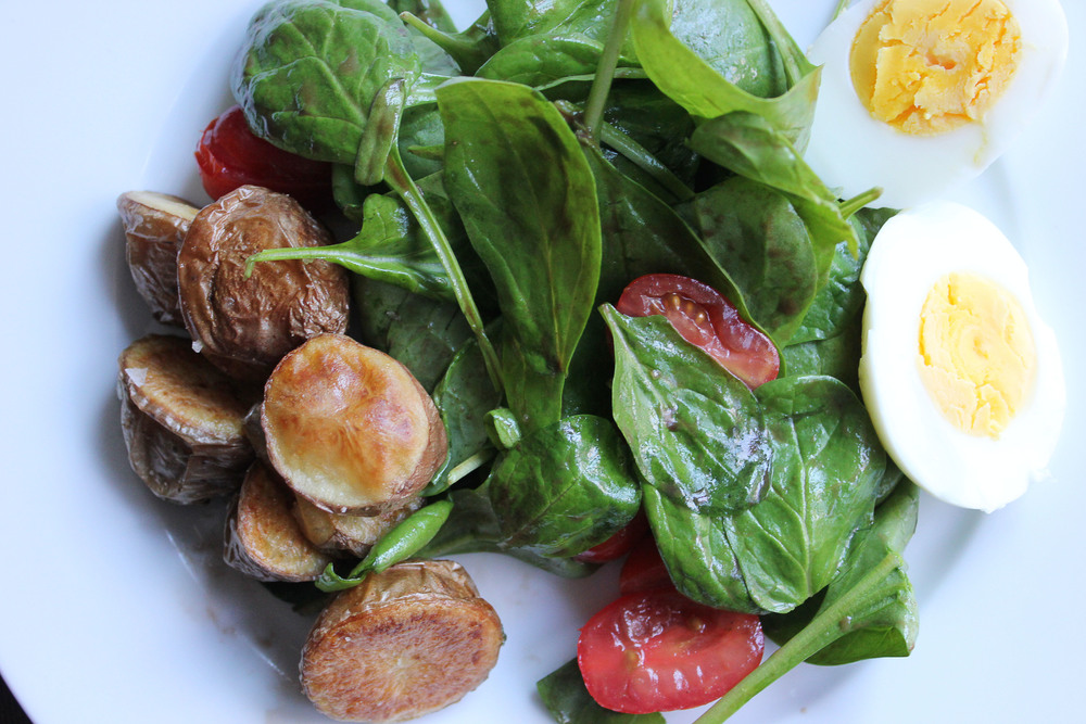 Parisian Dinner: Spinach salad, roasted potatoes, hard boiled egg - www.fancycasual.com