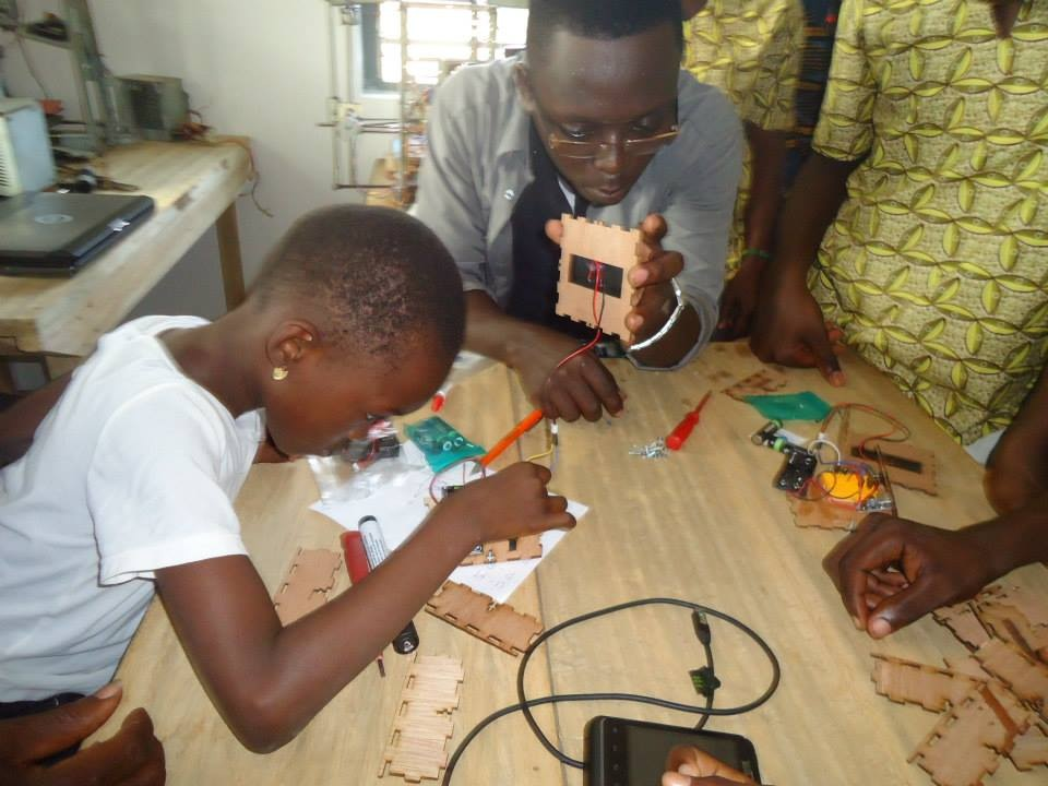 A young girl in at our partner, WoeLabs, in Togo (Lome) building our inaugural DIY Solar USB Charger Kit.