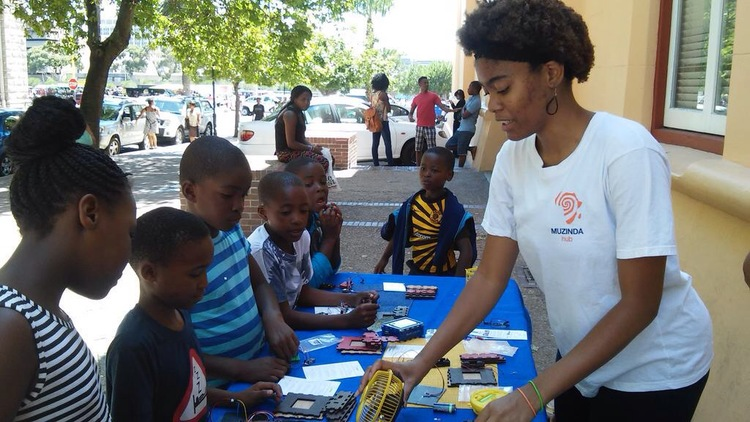 MCN Alumna Netia McCray (Millennium Fellow '14, MIT '14) teaching students in Cape Town, South Africa how to assemble her organization's DIY solar power USB charger for mobile devices.  Learn more about her work and the impact of the MCN here.