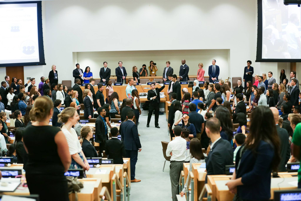 Sam Vaghar leading a group exercise during his reamrks at MCN's conference at the United Nations. 500 young leaders joined together alongside actor Terry Crews and more global leaders.