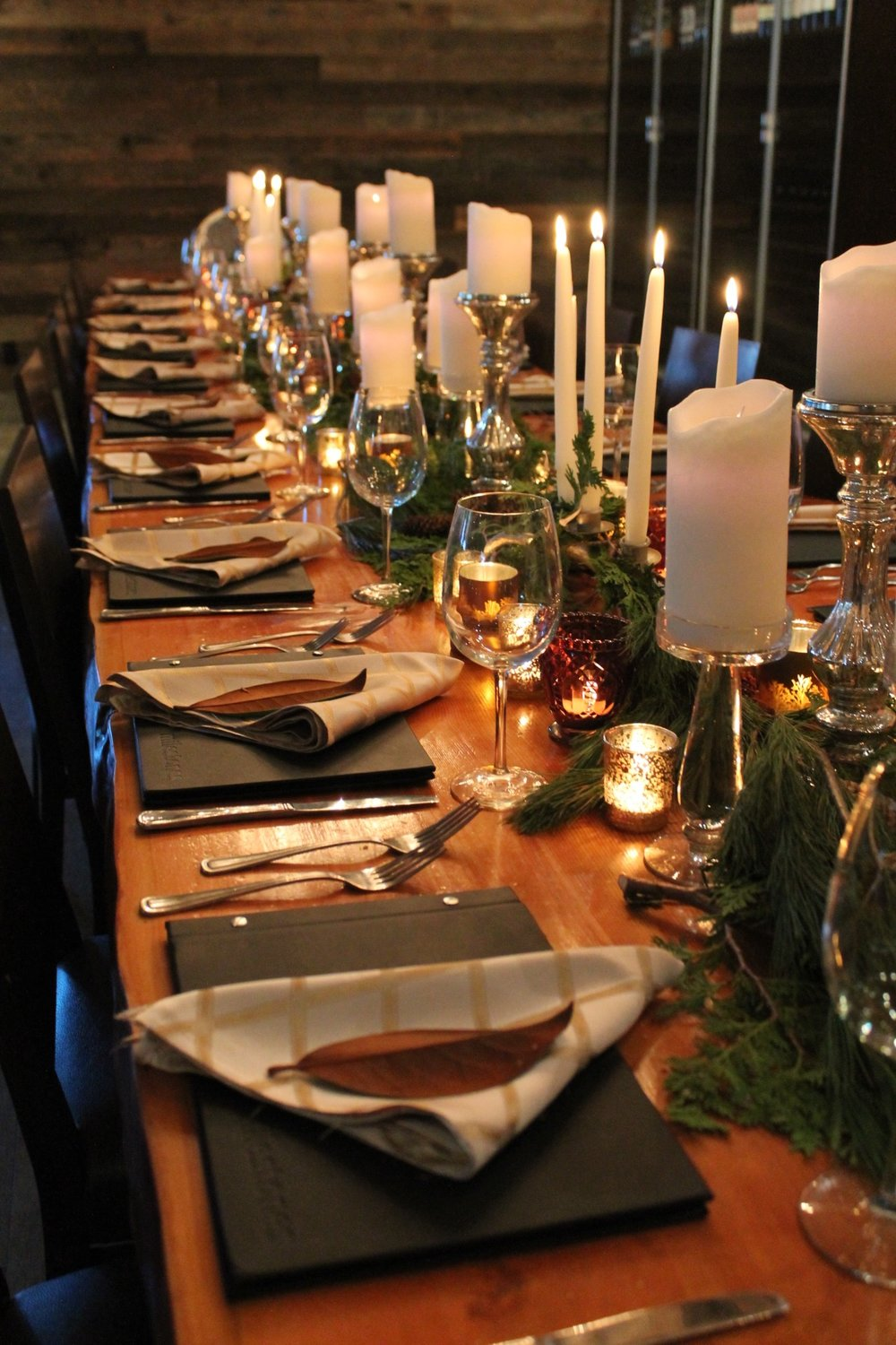 Holiday Table Settings for a private event, A touch of masculinity and a holiday vibe, Magnolia leaves and black menus. Sharp.