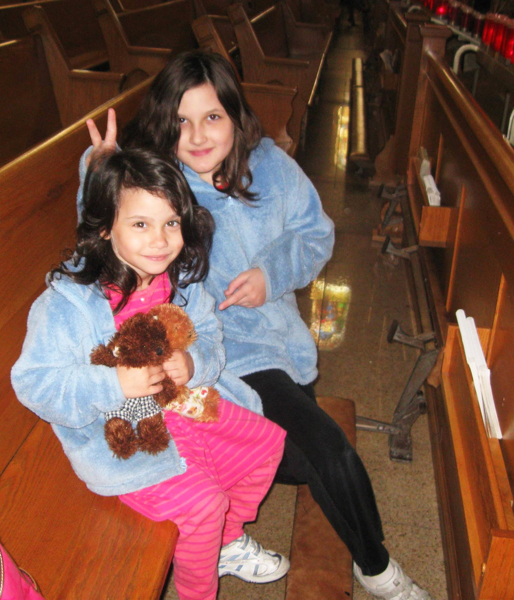 My sisters, Clara & Kathryn, at Mass circa 2010