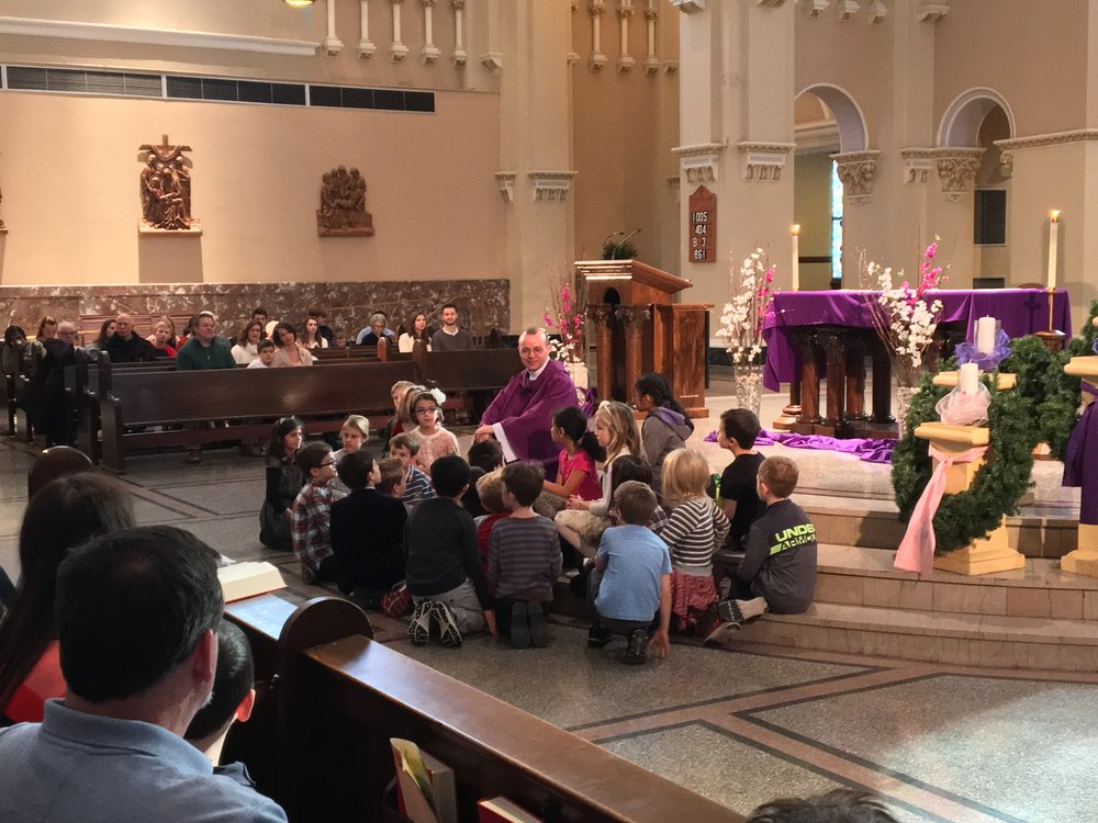 Fr. Robert gives a special homily for the children at an Advent Mass, December 2017
