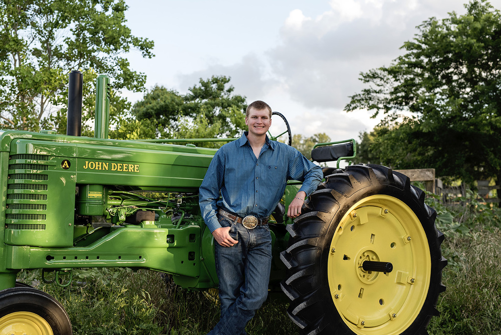 senior boy with restored john deere tractor, photos