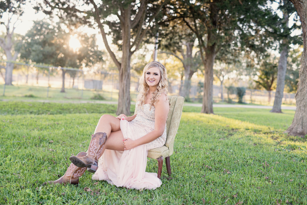 senior portraits in prom dress and boots