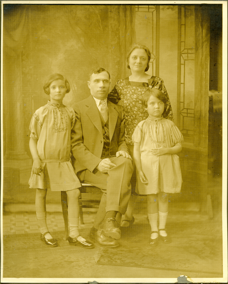 A friend brought me this image, a very old and faded print that included her mother (the girl on the left) with her family. Removing the yellow color cast and bringing back tonal balance was a fairly easy process. See the next image.