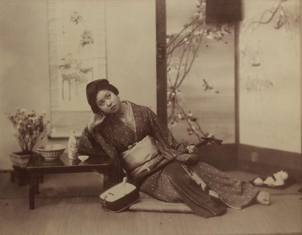 Woman Drinking Sake and Holding Shamisen