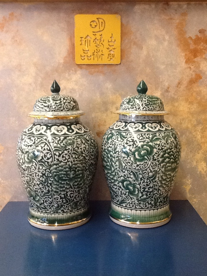 Mid-sized green and white contemporary Temple Jars with gold edging.
