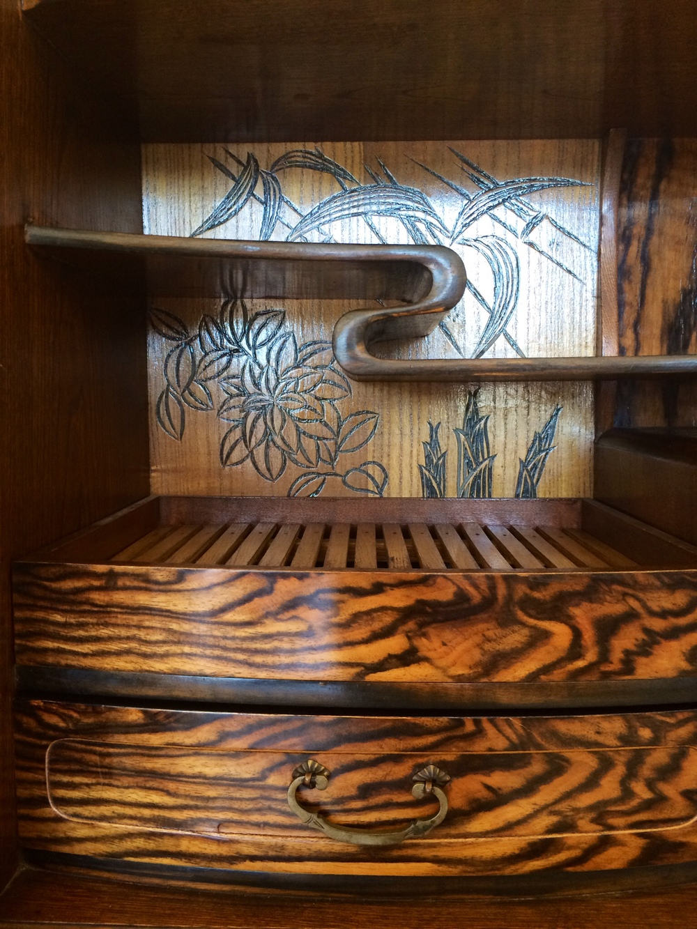 Detail of the beautiful craftsmanship of this persimmon wood tea cabinet.