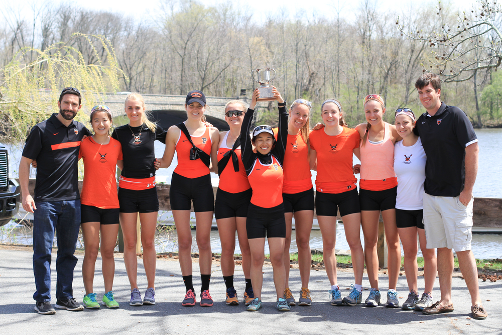 The lightweight women's 1V poses with coaches Paul Rassam and Hank Zimmerman after winning the class of 2006 cup over Georgetown