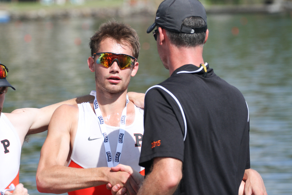 Patrick Watt '18 shakes hands with Coach Marty Crotty after claiming bronze in the 2VL final
