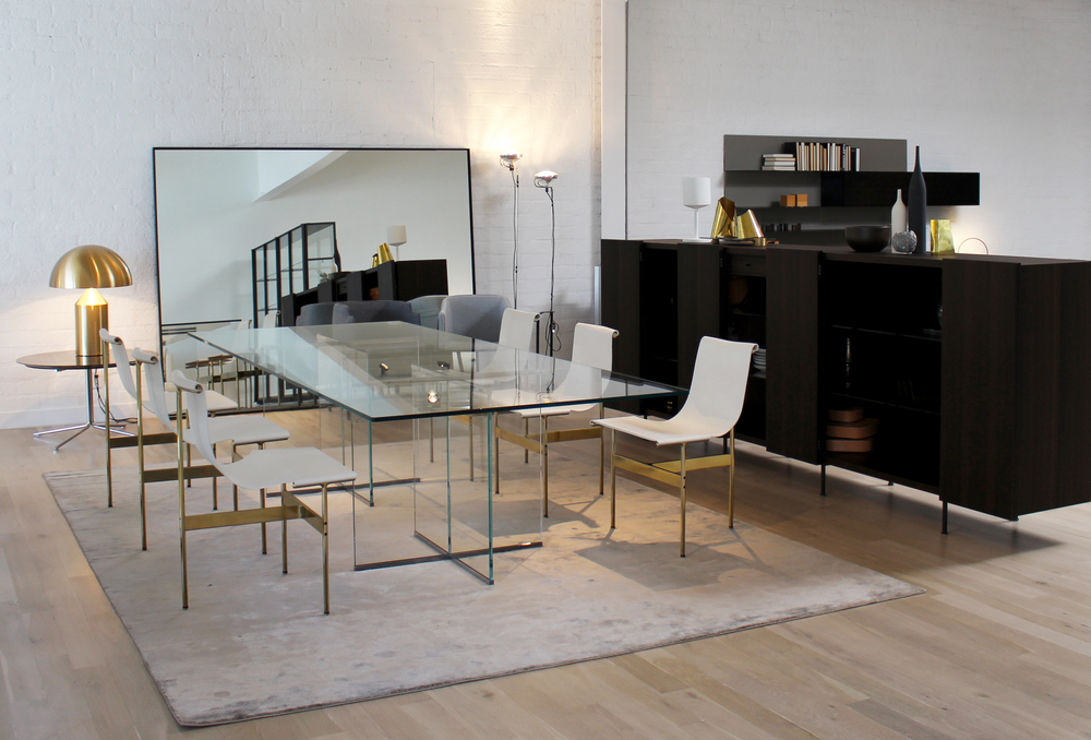 The Eros dining table by Gallotti & Radice is now on display with the TG-10 dining chairs  by Gratz  in  b  rass and white saddle leather.   The T iller storage cabinet in eucalyptus is by Porro, the Gold Atollo table l amp is by Oluce.   #galotti&radice #oluce #gratz #modern #architects #designers #design #LosAngeles #moderninteriors
