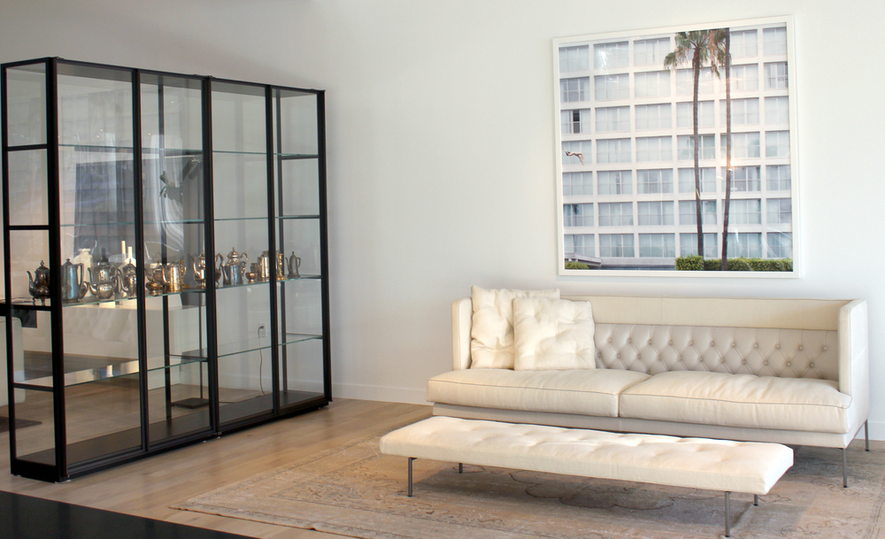 This vignette features the Lipp sofa and bench Living Divani with the  Ex-Libris iron and glass display cabinet by Porro,  Art by Scarlet Mann.  #livingdivani #porro #salvatori #pierolissoni #scarletmann #modern #architects #designers #design #LosAngeles #moderninteriors