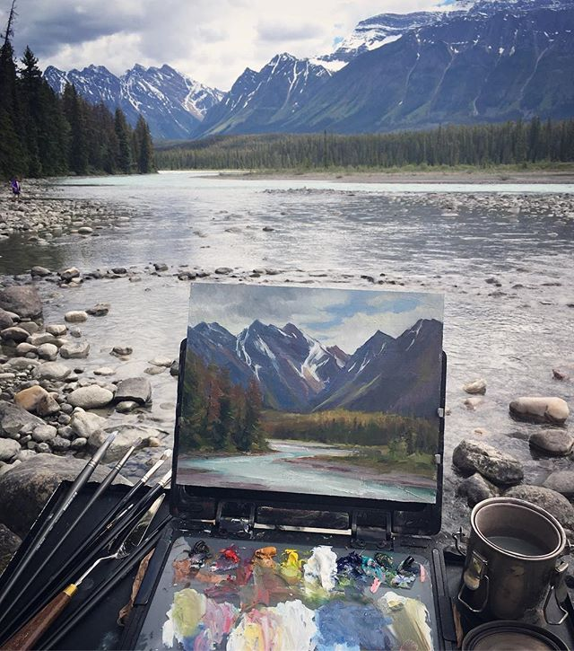 """#Repost @annarose_artist ・・・ Somewhere in #jaspernationalpark . We spent many hours in the car today trying to take it all in, but I also had a chance to stop and do this 8x10"""". If I were Canadian I would want to hibernate all winter, but it sure is glorious in the summer! . . . #banff #canada #oilpainting #pleinairpainting #pleinair #sketchbookeasel #edgeprogear #mountains #banffbabymoon #greymattersbrushes #michaelhardingpaints #juneinjaspernationalpark #banffpleinair #banffpainting #canadianrockies"""