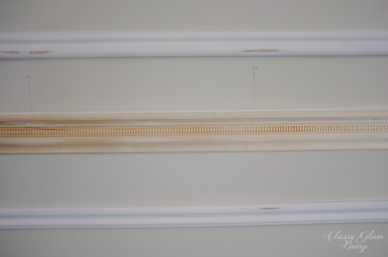 Close-up of frame trims and chair rail details.