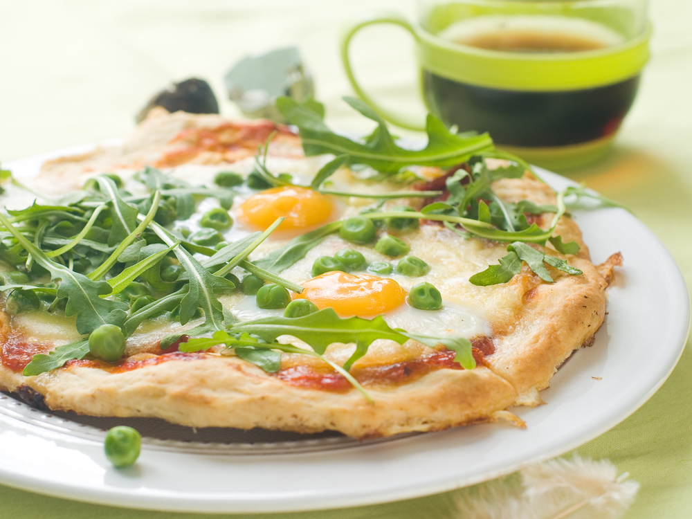 Breakfast pizza with eggs, arugala, and sweet peas.jpg