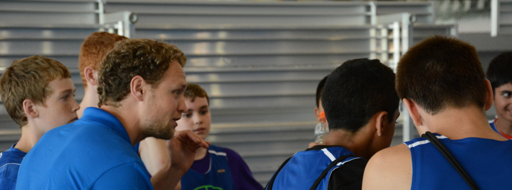 Matt talking to the U13 Boys in a timeout at tournamnt play.