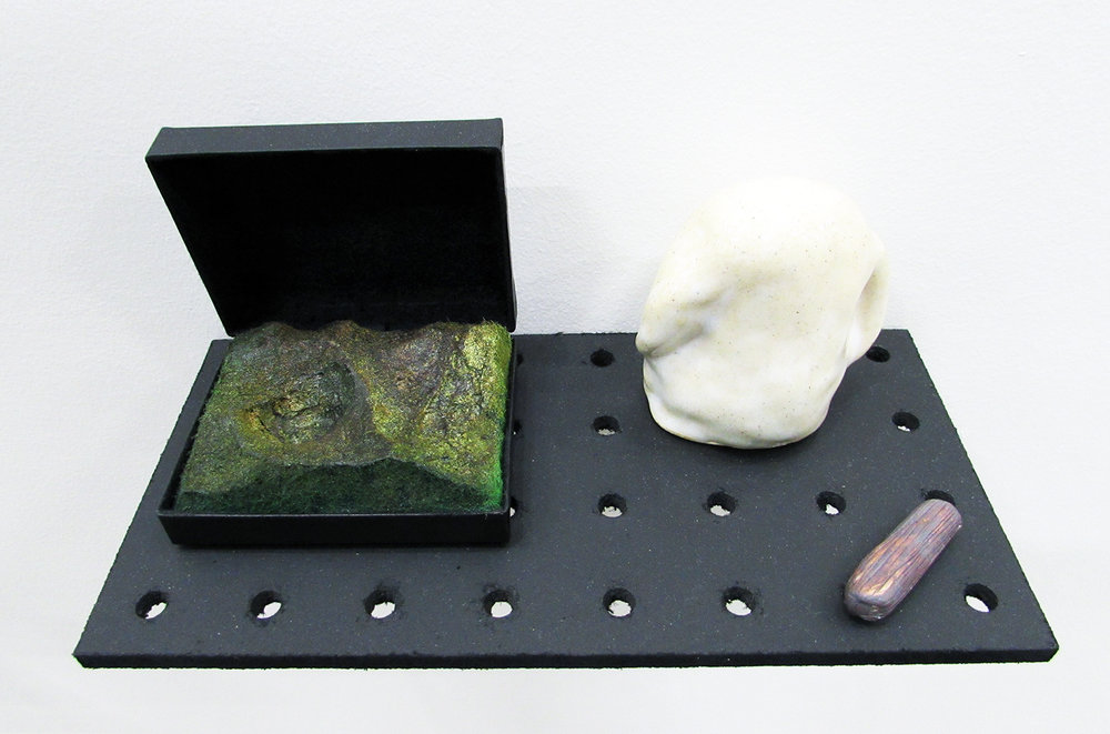 """tampered with dieter..."" ceramics and found case with inserted landscape, 2015"