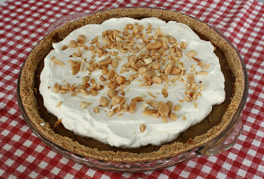 Before heading off to the party, the pie was topped with whipped cream and chopped salted peanuts. YUM!