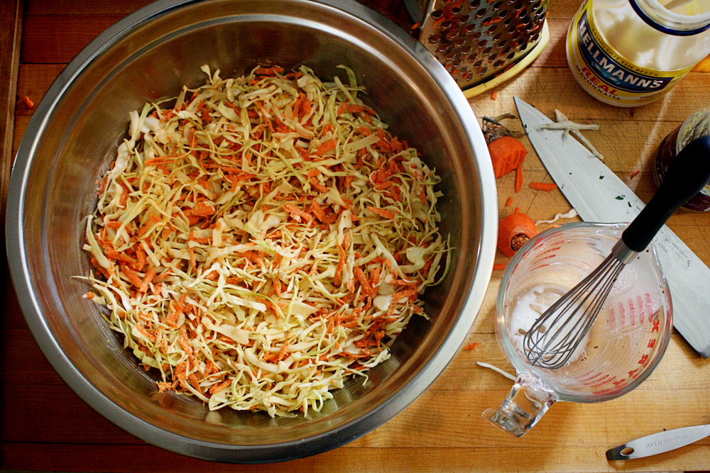 Taste the dressing. Adjust as needed. Pour it over the veggies*. Toss & serve. *This slaw isn't always as good after a day or two. If you think you will end up with a lot leftover, you can halve the recipe OR dress as much slaw as needed for the meal while reserving (separately) some of the veg & dressing to be combined later in the week.
