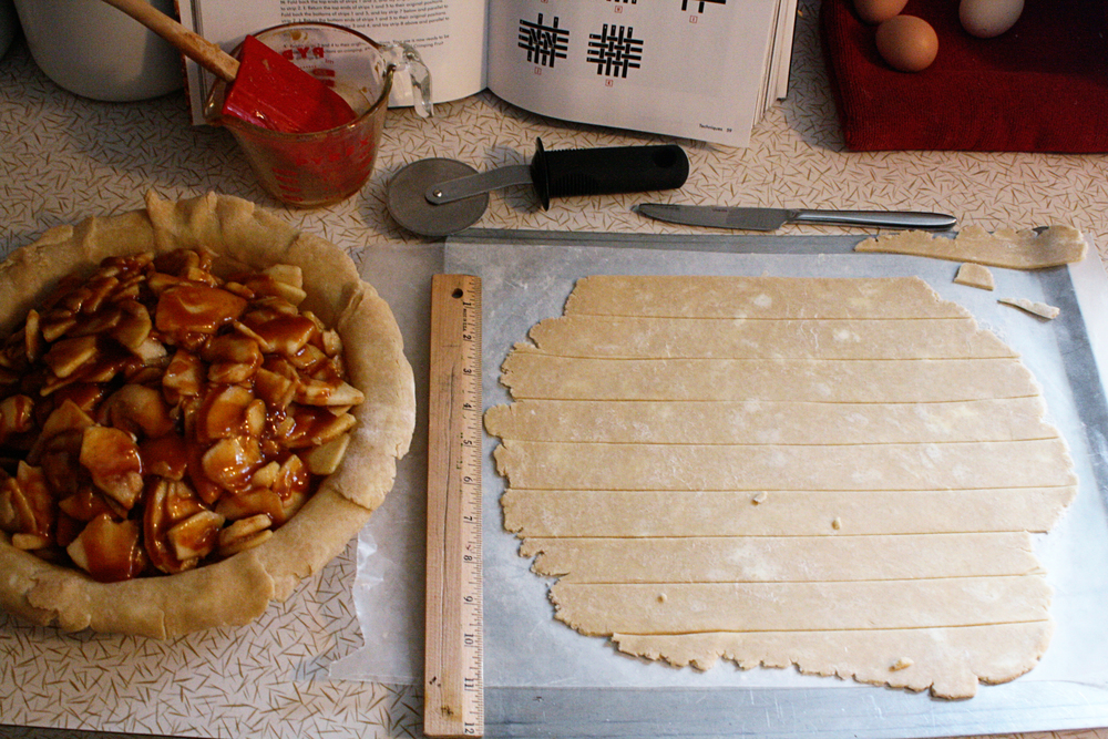 The Cara-Sel has been drizzled over the apples in the pie shell and the strips of dough are ready for latticing (probably not a real word).