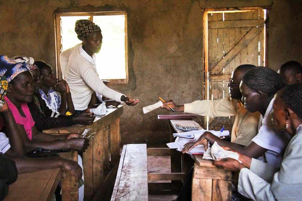 Micro loans being paid, Kiambu, Kenya