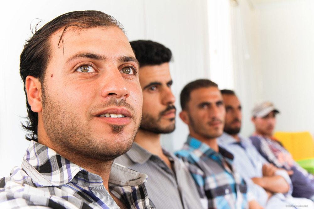Camp refugees aren't allowed to work. Idle time is difficult. Here nonprofit JHAS teaches leadership skills to men, eager to be productive and progress in life.