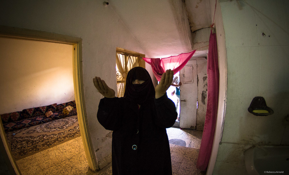 Syrian refugee mother, living in a 'squatter' home outside Amman, lost one of her sons in the war. Zaqra, Jordan