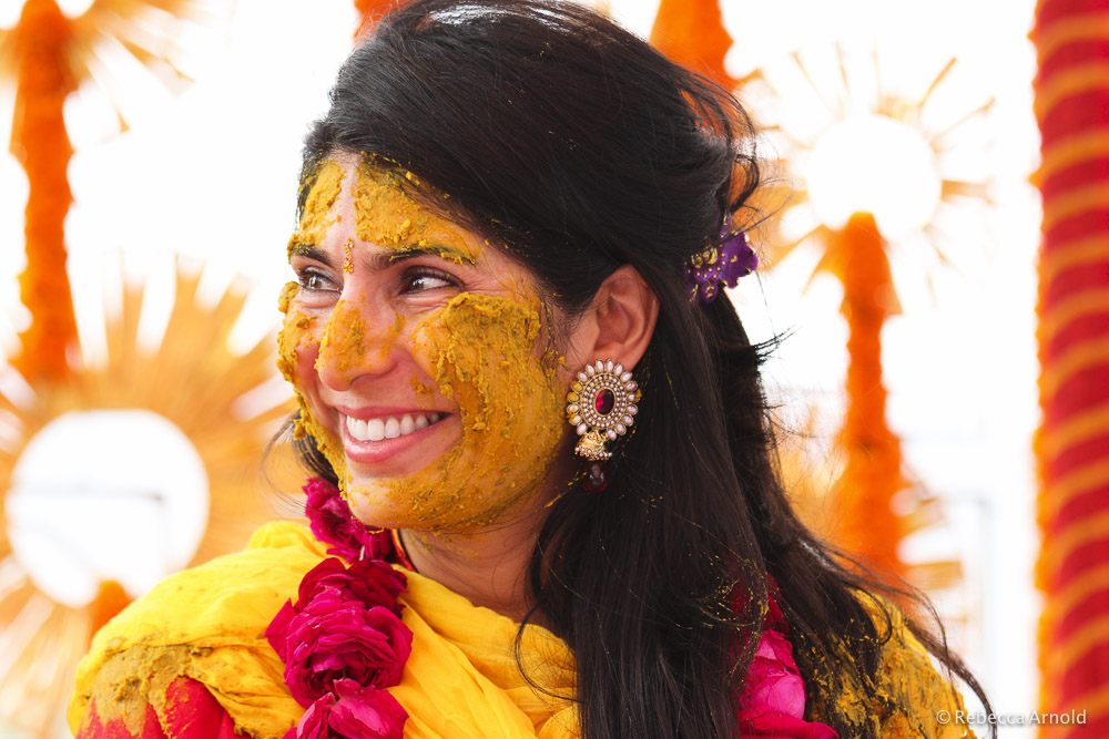 Haldi, turmeric paste is spread on the bride for good luck and good health.