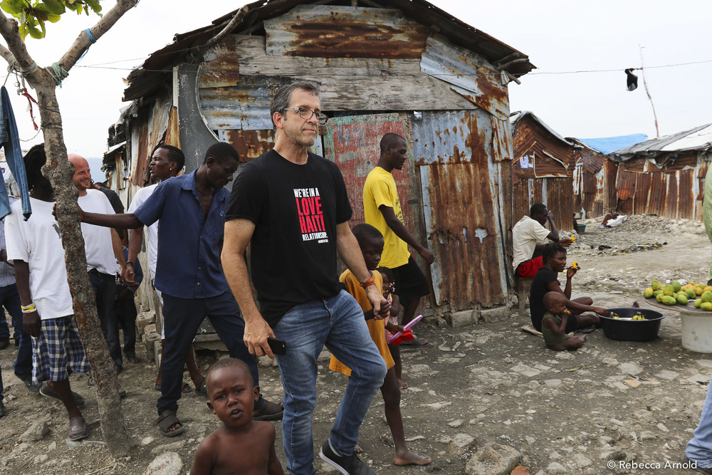 Kenneth Cole, long-time friend and  sponsor  of St. Luke Hospital, walking with the people of Cite Soleil. It's the largest slum in the western hemisphere, and with his support, St. Luke built the most equipped clinic servicing the 200,000-400,000 people living here.