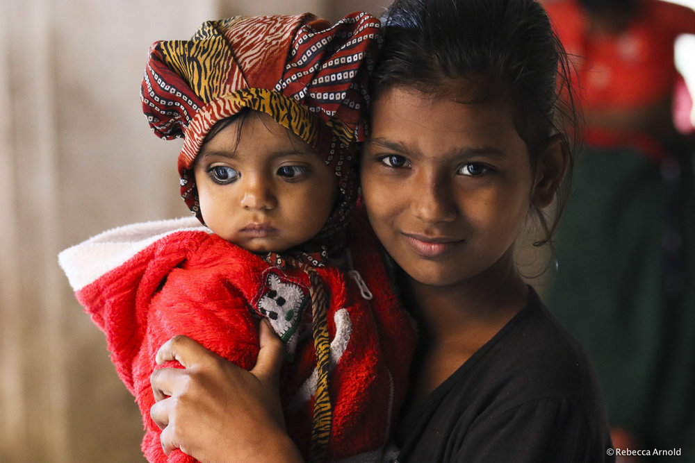 "Girl with Baby, India 2015   16"" x 24"" 