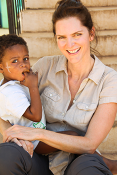 Rebecca with a young boy at an orphanage, Haiti