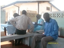 Cliff (in blue) at Bulangilio clinic