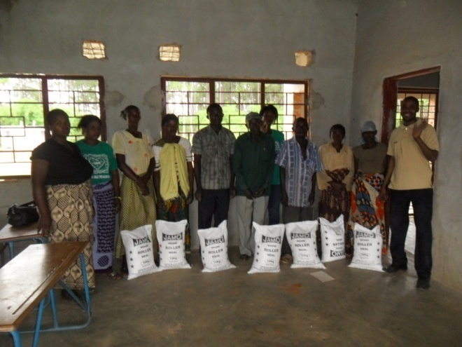 Stanley in a brown T/shirt on the right and the volunteers giving food to TB/HIV/AIDS patients in Mugala community