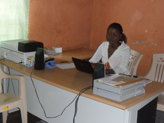 Mrs. Mwiche C. Bwalya CAM Community Programs Administrator working in the office at 3038 Kwacha East Kitwe